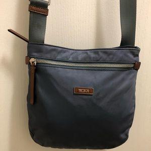 Authentic Tumi gray crossbody bag